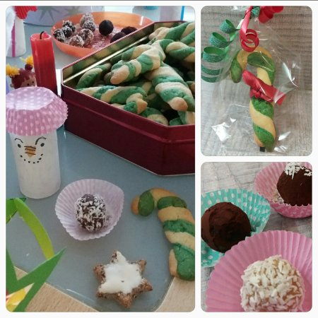 Zuckerstangen und Pralinen in der Weihnachtsbäckerei